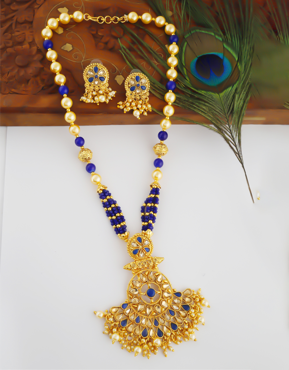 Blue Colour Fancy Gold Finish Styled With Moti Beads Pendant Set