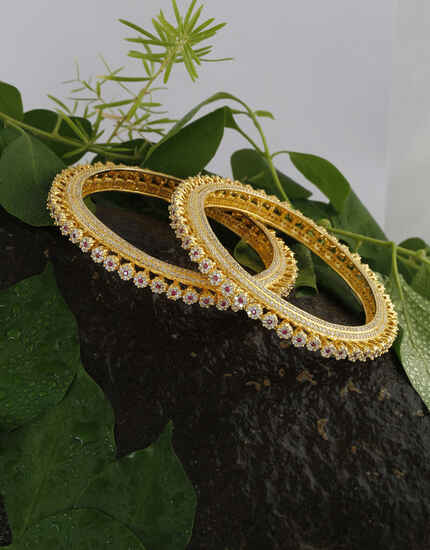 Anuradha Art Jewellery Amazing Golden Finish American Diamond Bangles