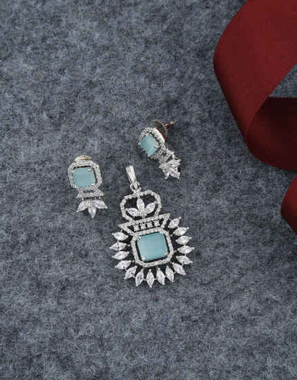 Very Classy Pale Green Colour American Diamond Pendant Set Design.