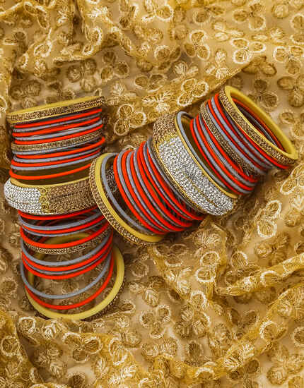 Dazzling Grey and Red Colour Matching Bangles with Golden Kada Online.
