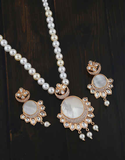 Dazzling Rose Gold Diamond And Kundan Studded American Diamond Pendant Set.