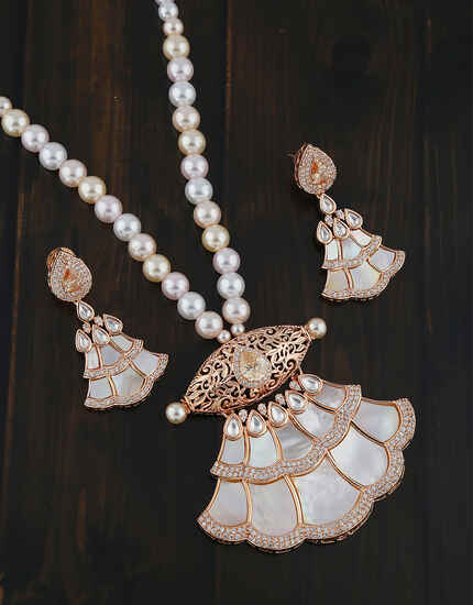 Unique Rose Gold Finish Kundan And Diamond Studded American Diamond Pendant Set.