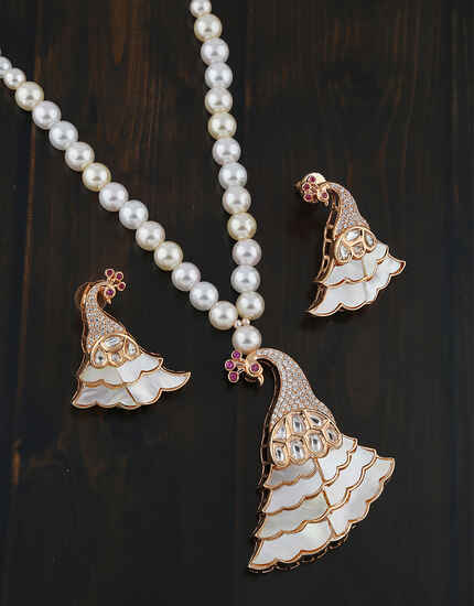 Pink Colour Peacock Inspired American Diamond Pendant Set Design Online.