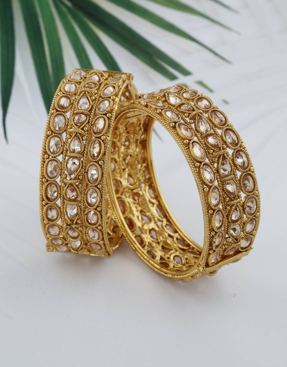 Sparkling golden bangles decked with LCT stones for women