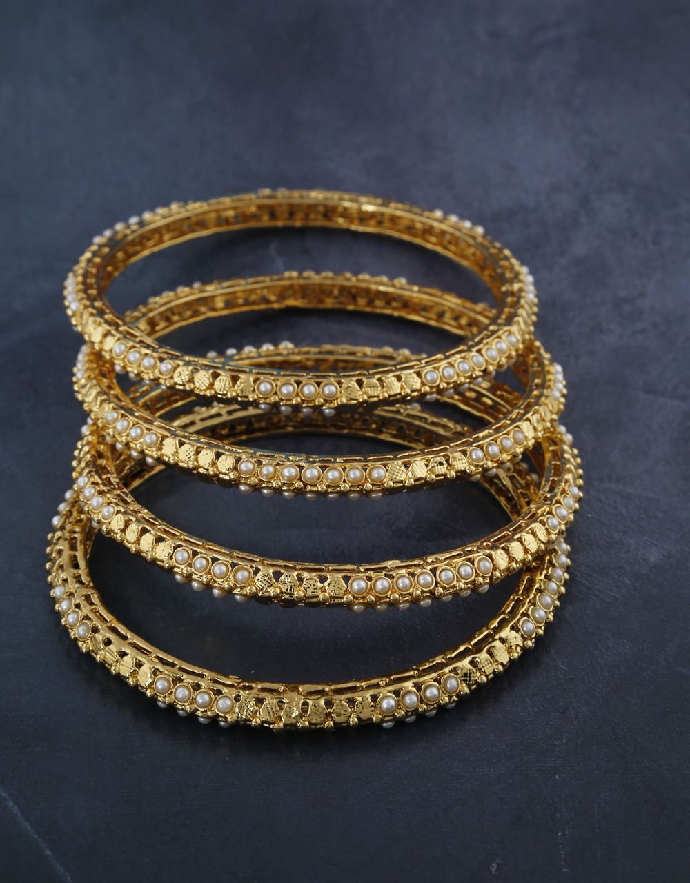 Fancy designer bangles decked with delicate pearl  for women