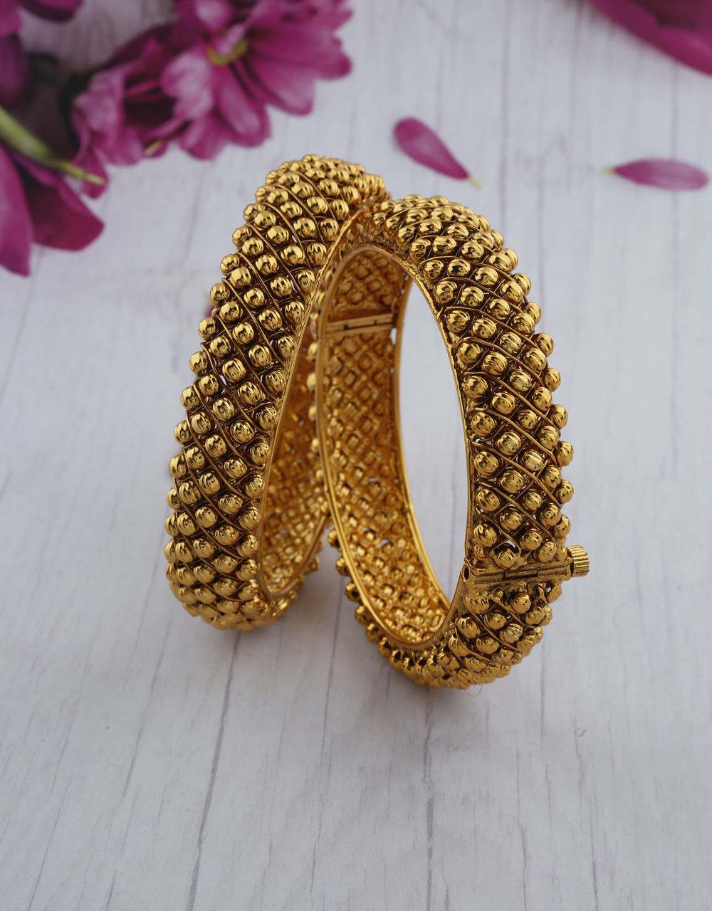 Fancy designer bangles decorate with golden ball bead for women