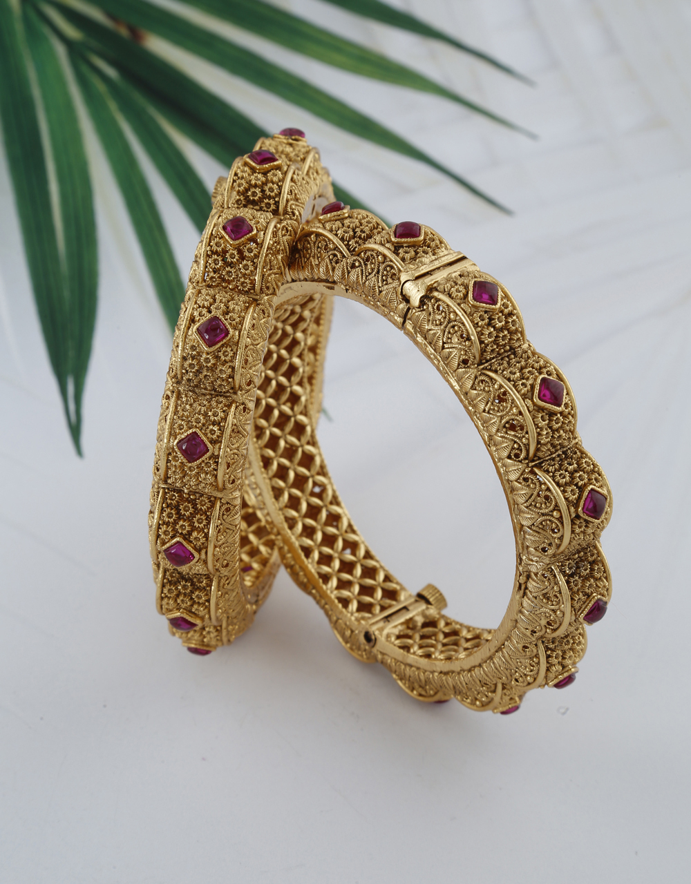 Ethnic designer bangles with matte gold finish decked with pink stones bangles for women