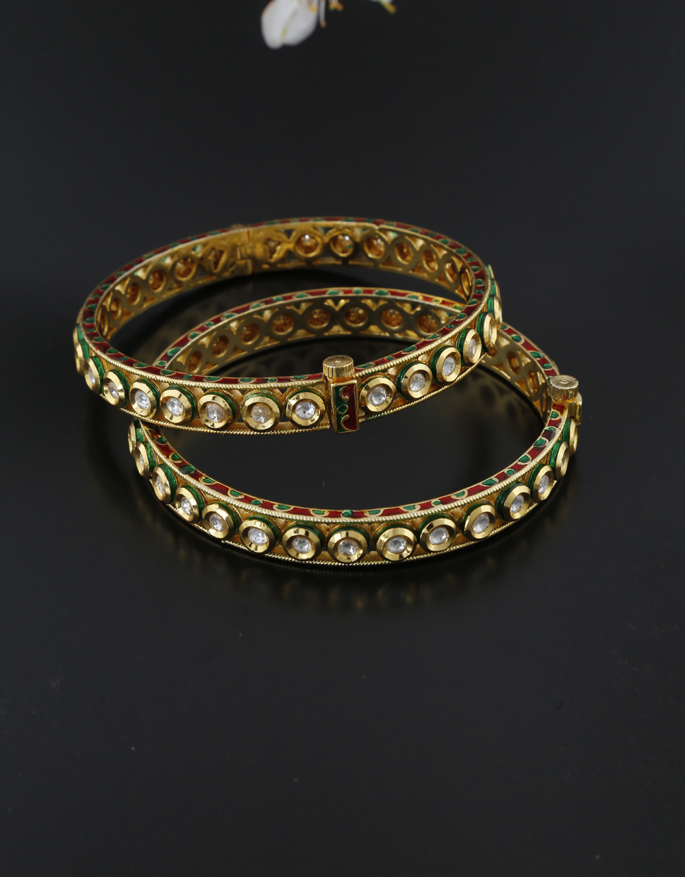 Round shape kundan studded with green colour finish bangles for women