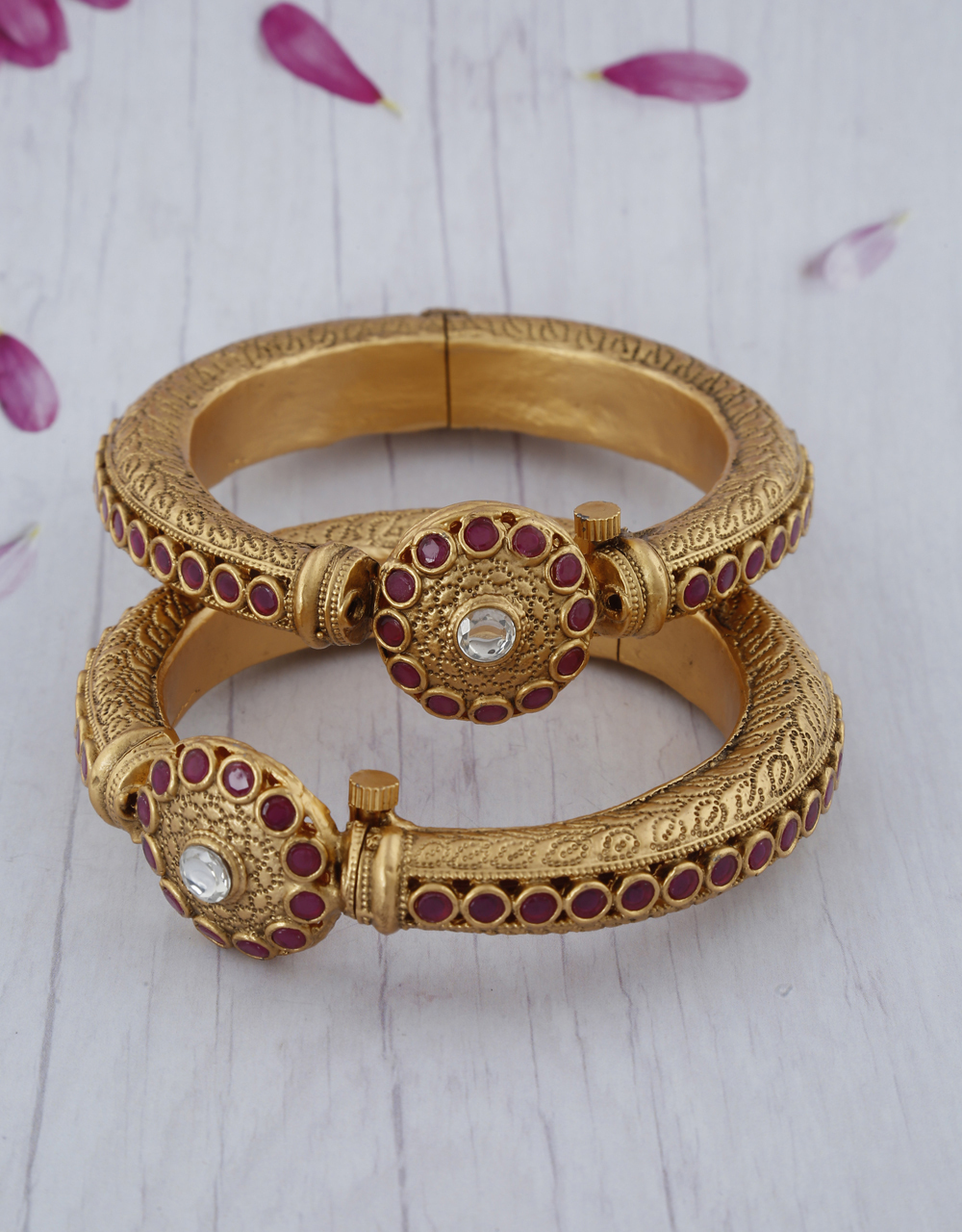 Round shape designer finely decorated with pink stone and matte gold finish bangles for women