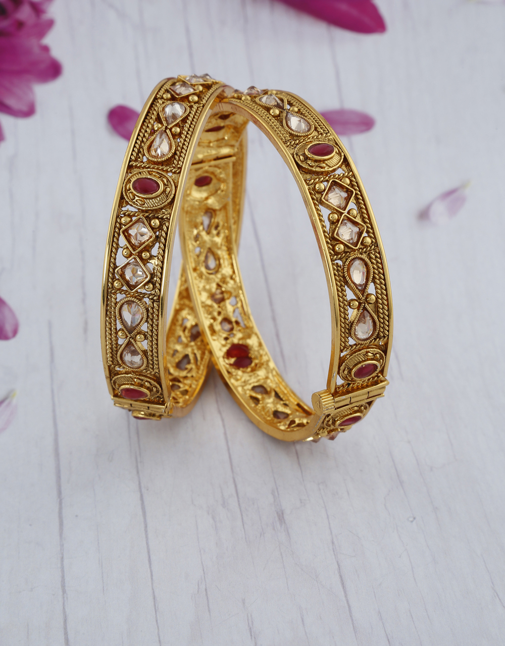 Fancy designer decked with red stone in a round designer with LCT stone crafted bangles for women