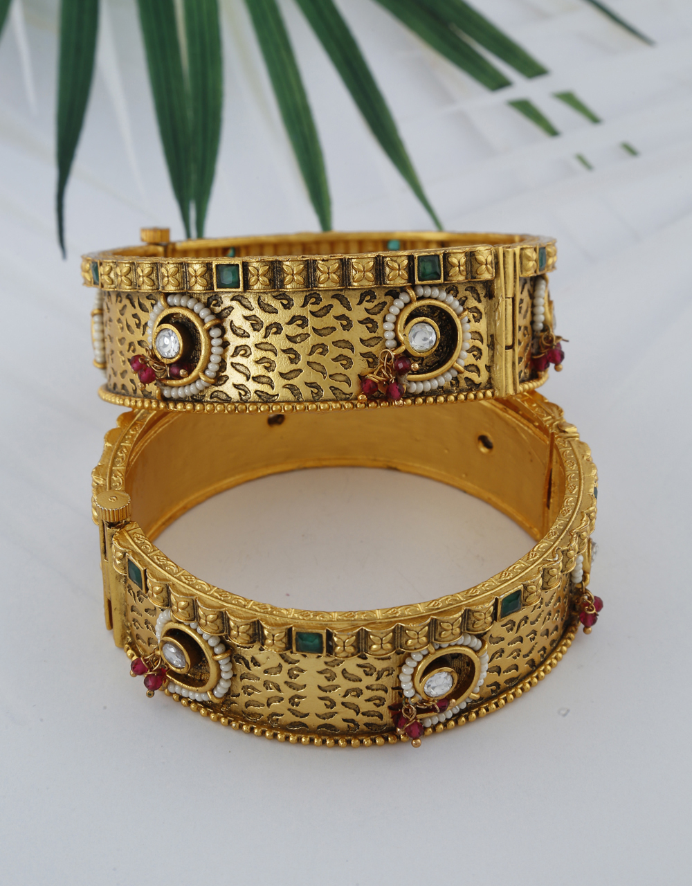 Antique designer decorated with pearl and green stone for women