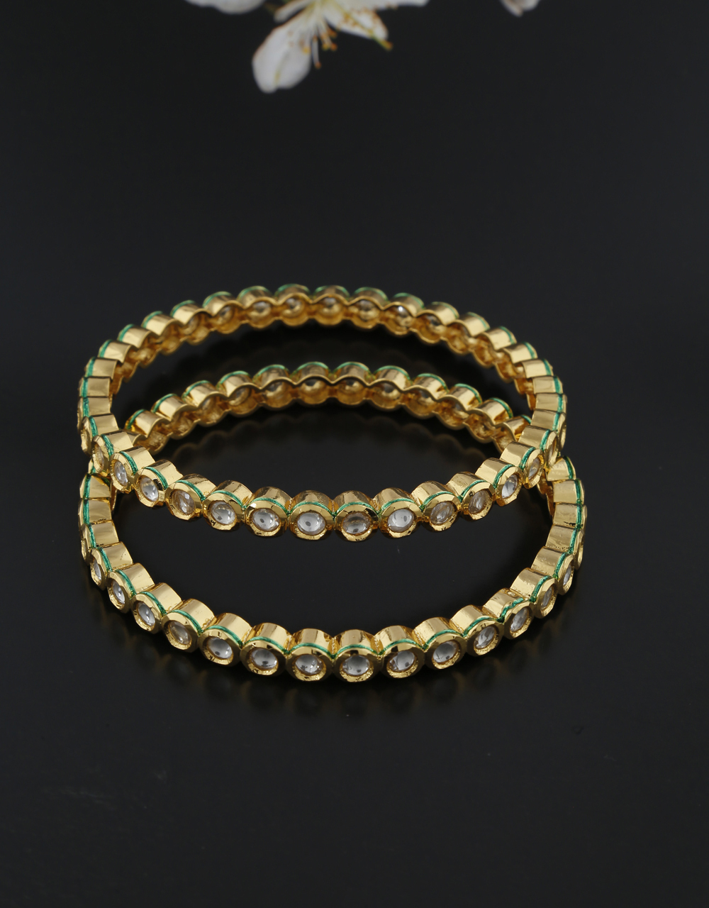 Round designer bangle with classy look studded with shining kundan bangles for women