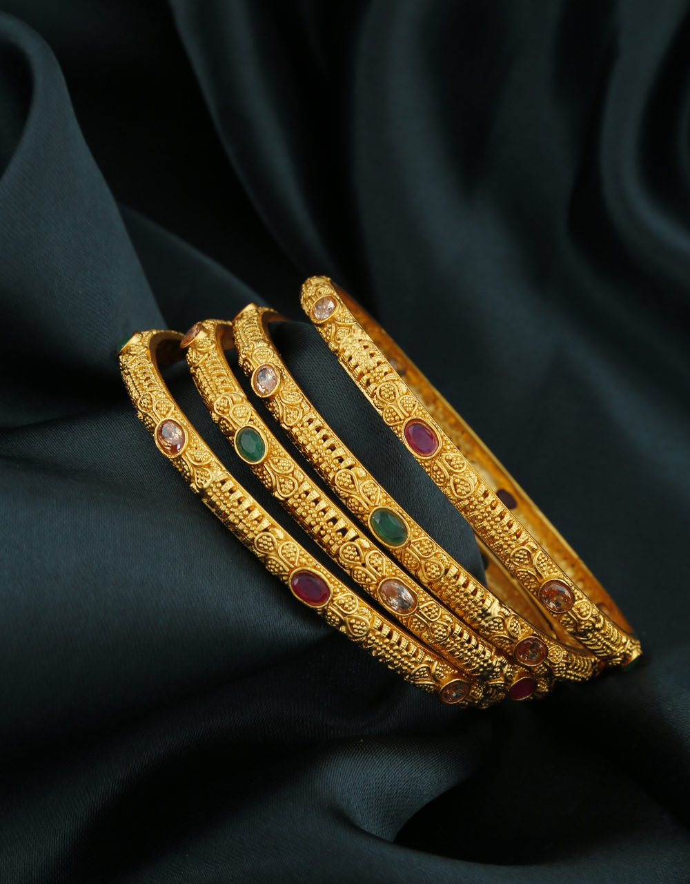 Fancy Golden Finish LCT Stone Studded Traditional Bangles for Women Online.