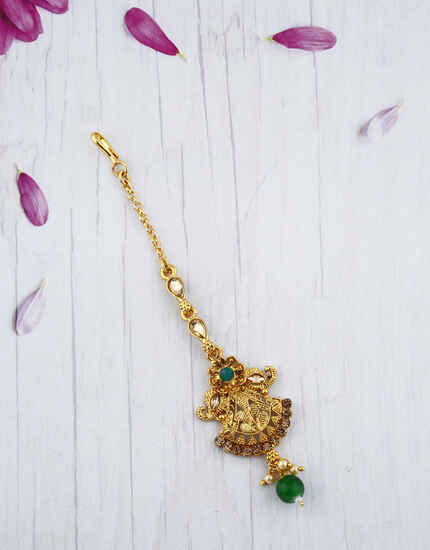 Traditional Golden Finished With Green Stone Droplet Maang Tikka.