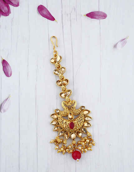 Trendy Red Colour Stone Droplet Maang Tikka With Golden Finishing.