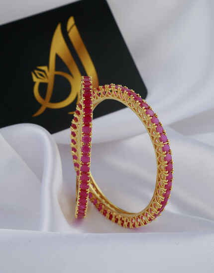 Pink Stones Studded With Golden Matt Finishing Bangles.