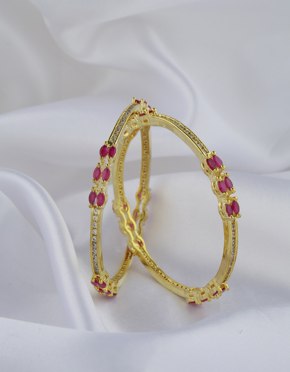 Dazzling Pink Stones Studded With Golden Matt Finishing Designer Fancy Bangles.