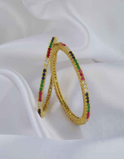 Dazzling White , Blue, Green And Pink Stones Studded With Golden Matt Finishing Designer Bangles.