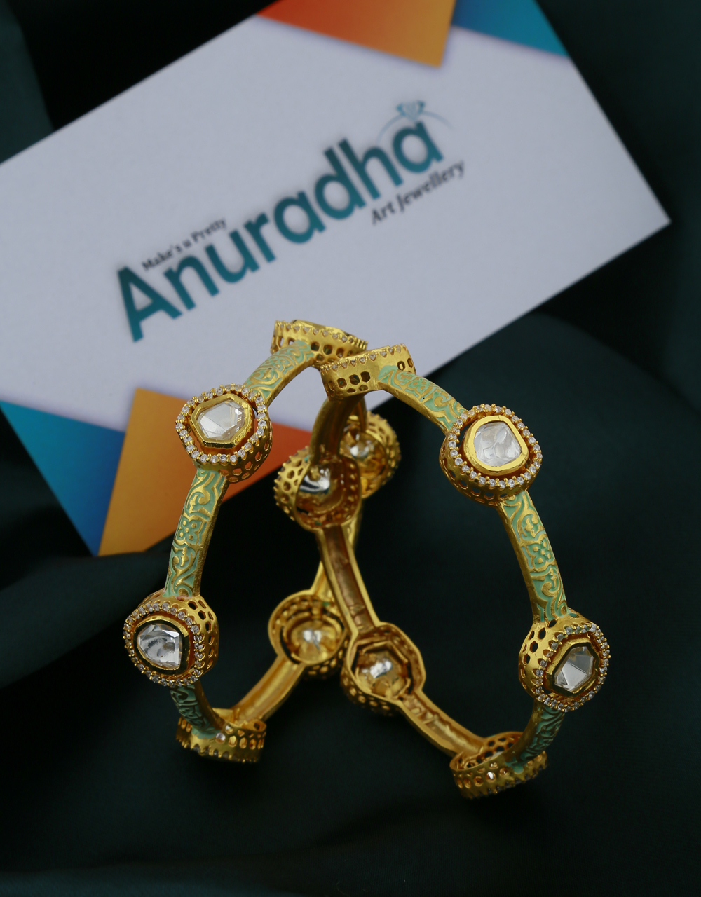 Dazzling White Stones Studded With Golden Matt Finishing Fancy Designer Bangles.