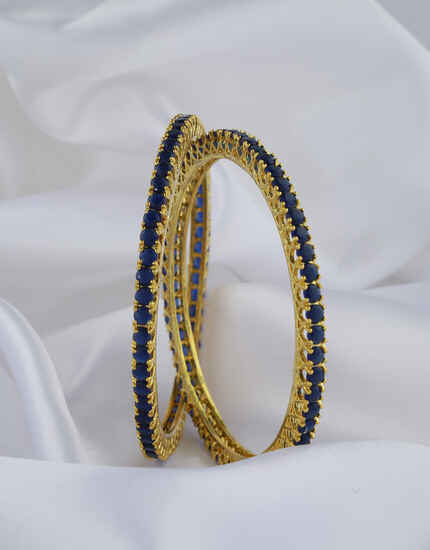Dazzling Blue Stones Studded With Golden Matt Finishing Fancy Designer Bangles.