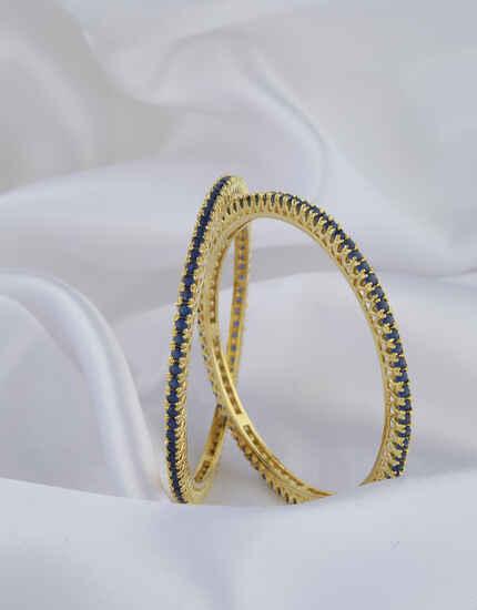 Dazzling Blue Stones Studded With Golden Matt Finishing Fancy Designer Bangles.