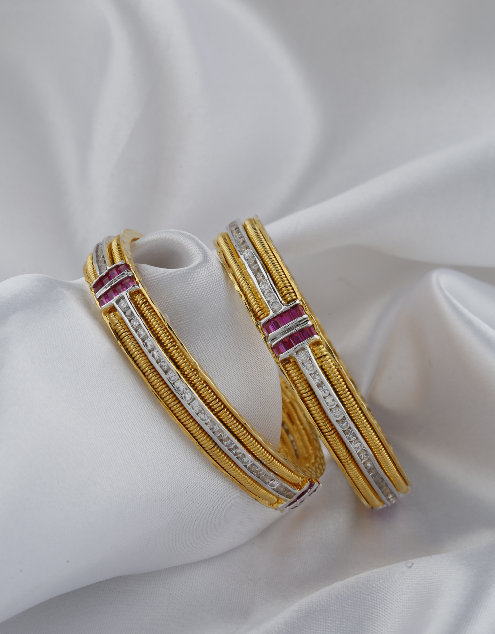 Adorable White And Pink Stones Studded With Golden Finishing Bangles.