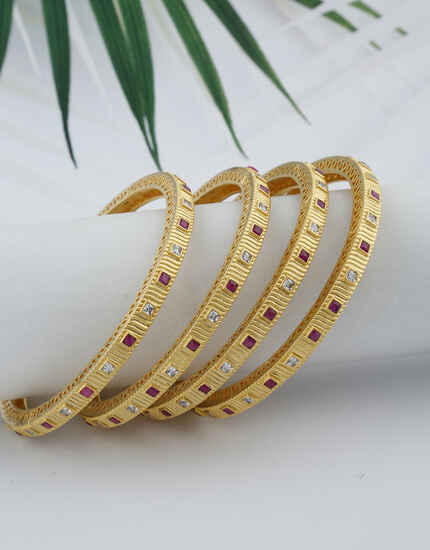 Very Classy Matte Gold Finish Rani and White Colour Stone Studded Traditional Bangles.