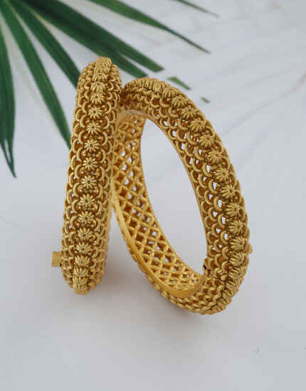 Glaring Golden Finish Floral Designed Traditional Bangles For Women Design.