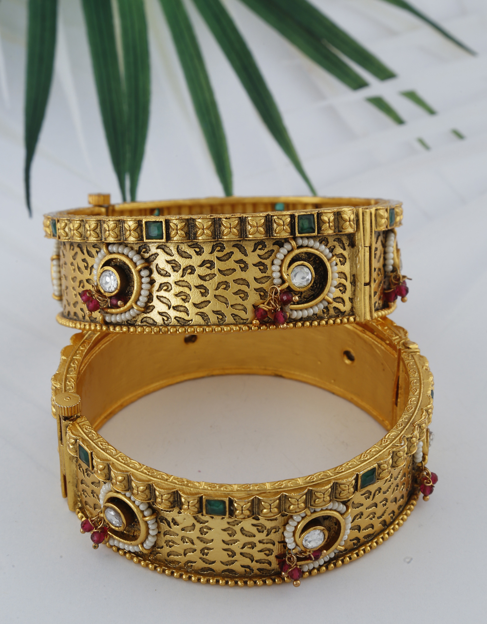 Unique Golden Finish Green Colour Stone Studded Traditional Bangles For Women.