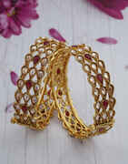 Very Classy Encrusted With LCT Stone Golden Finish Traditional Bangles Online.