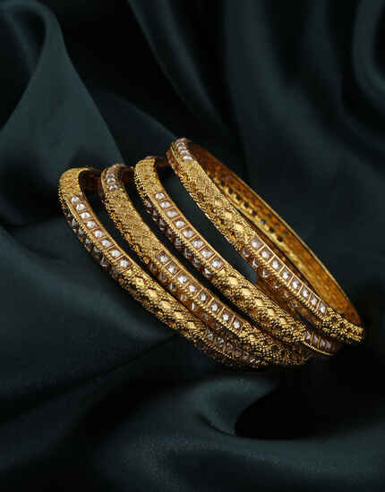 Exclusive Golden Finish Studded With LCT Stone Traditional Bangles For Women.