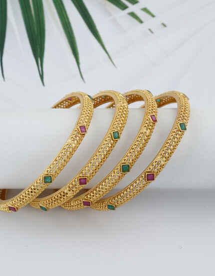 Multi-colour Golden Finish Embedded With Stone Traditional Bangles For Women Online.