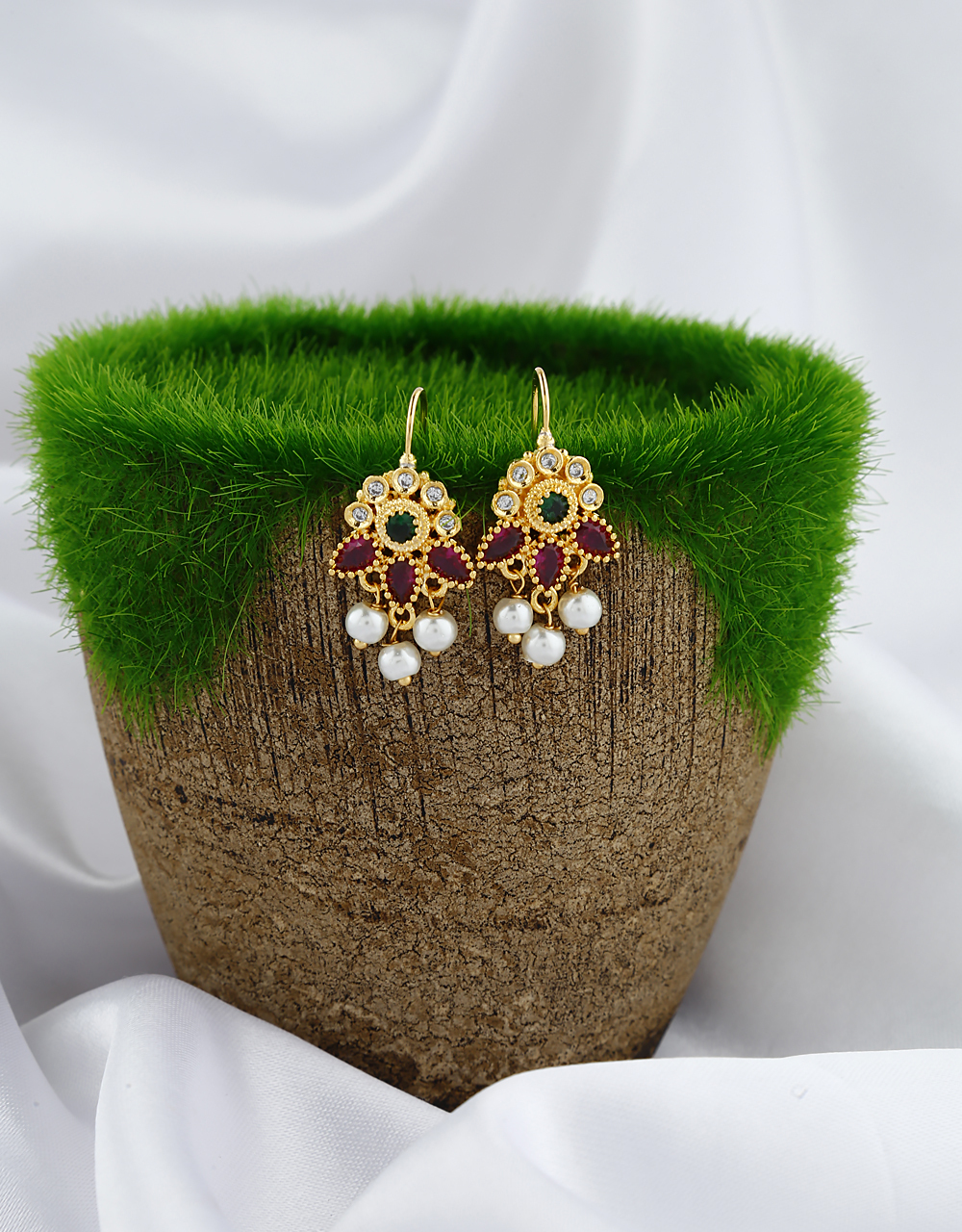 Attractive  pink and white stones studded  bugadi. With pearl droplet.