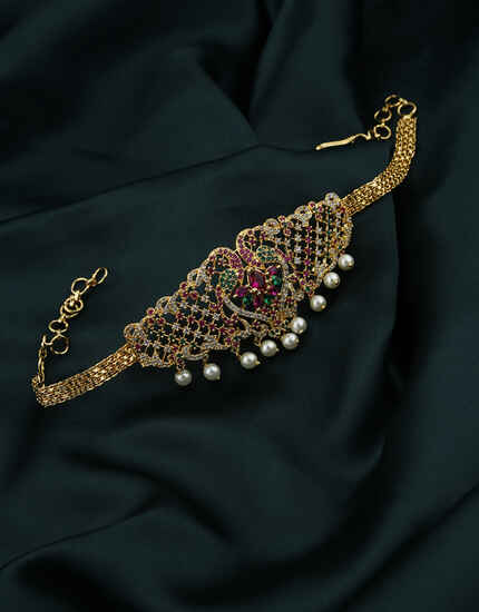 Classy temple design bajuband with pearl droplet and stones studded.