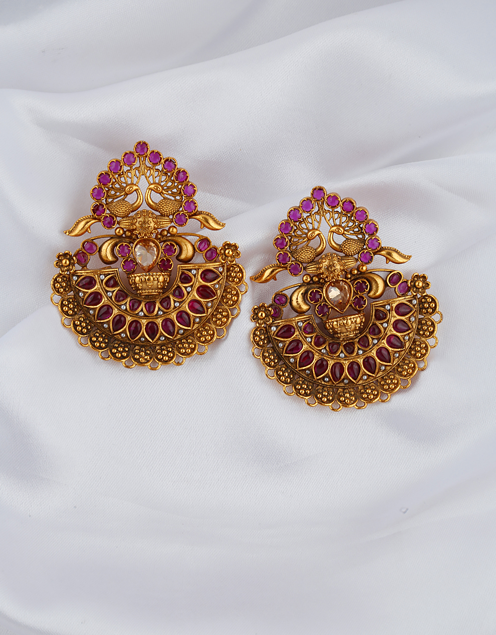 Ruby Stones Studded Traditional Golden Finish Pair Of Earrings.