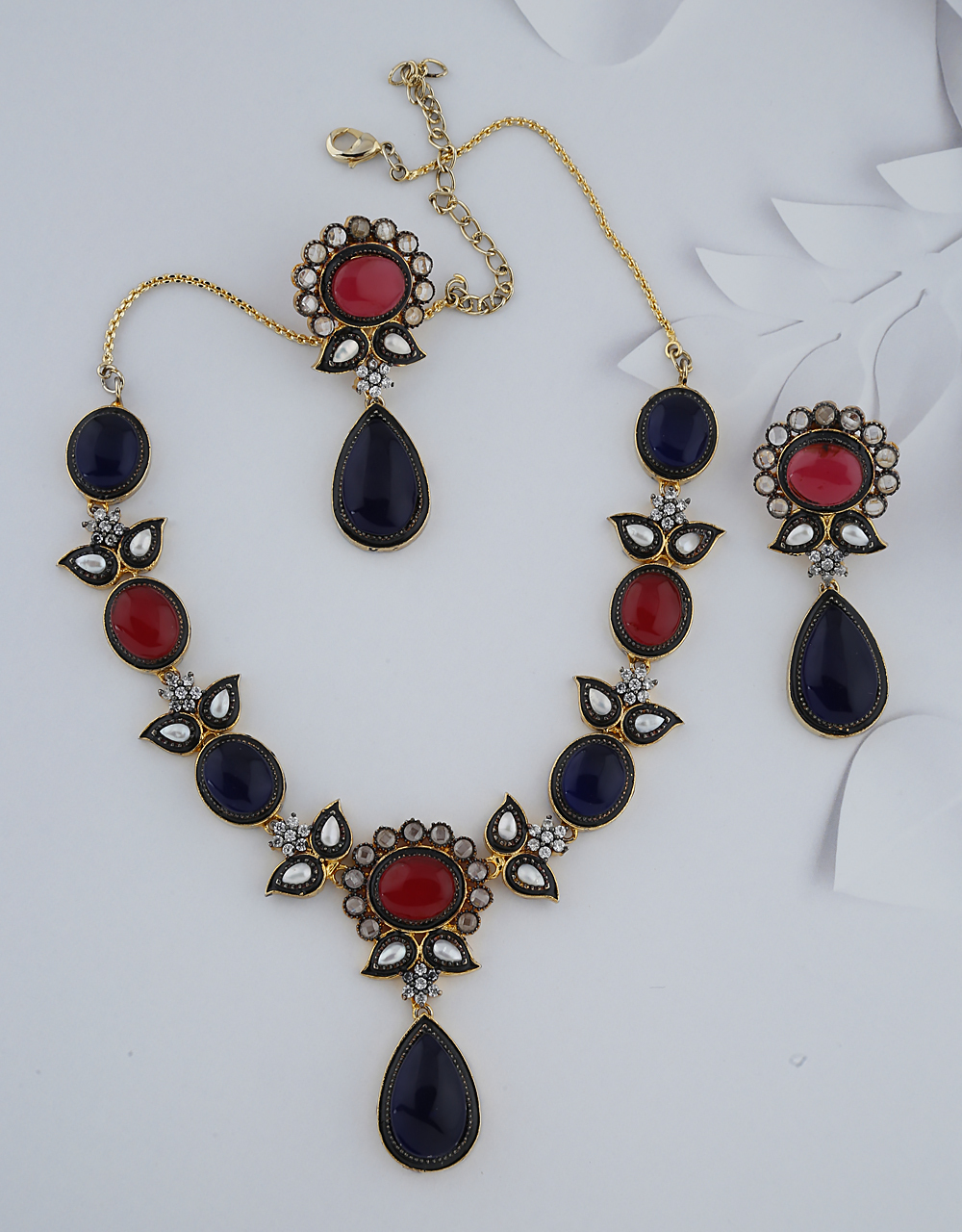 Blue And Pink Stones Studded With Black Metal Finishing Necklace With Earring Set.