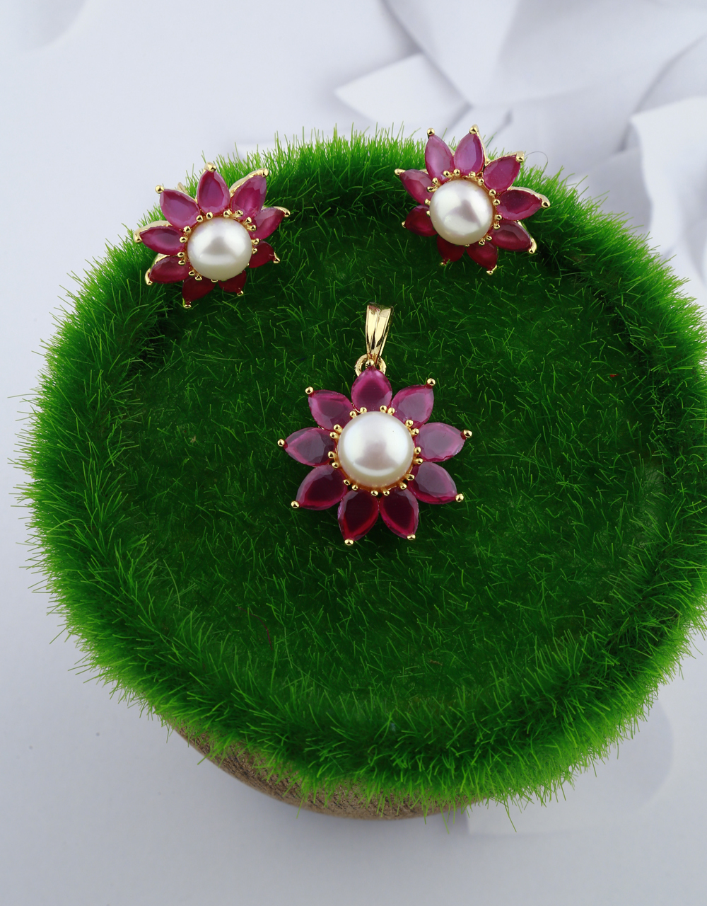 Ruby stones studded with pearl bead gold finish pendant with earrings set