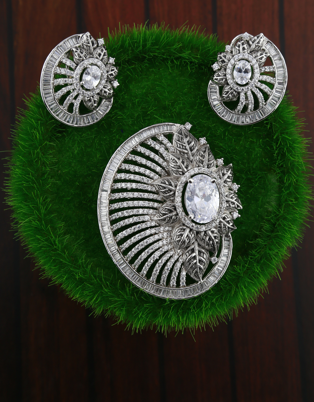 American diamond studded fancy silver-plated pendant with earrings set