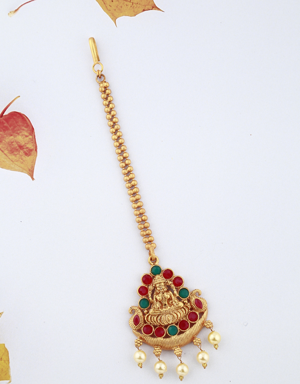 Attractive Temple Design Red And Green Stones Studded Golden Finish Maang Tikka For Girls/ Woman