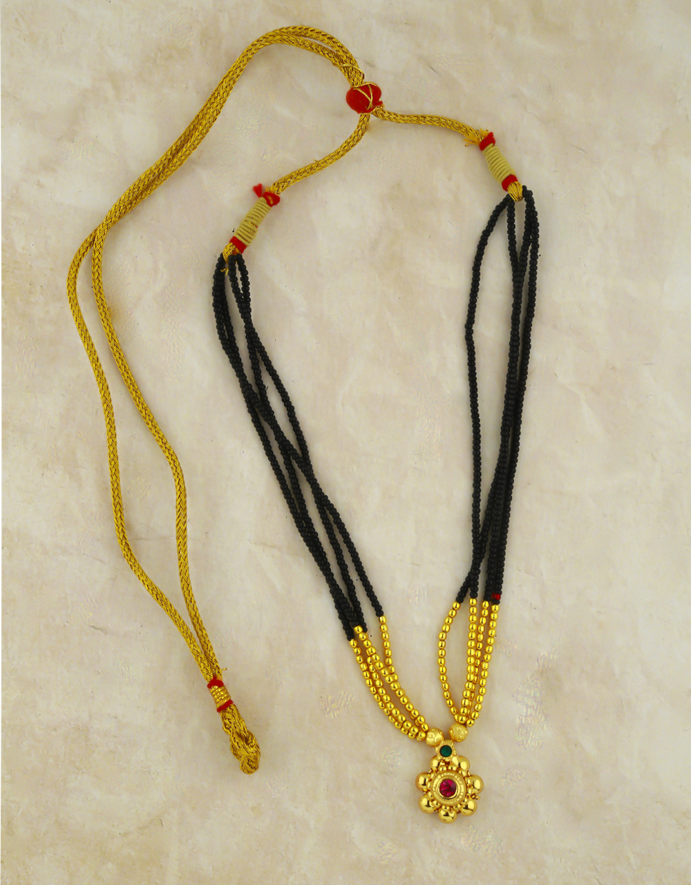 Adorable Thushi Mangalsutra for Women Styled with Round Pendant
