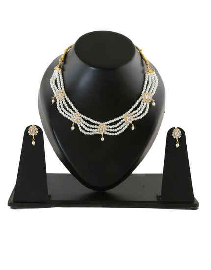 Gold Finish Tikada Set Studded With Stones Moti Necklace