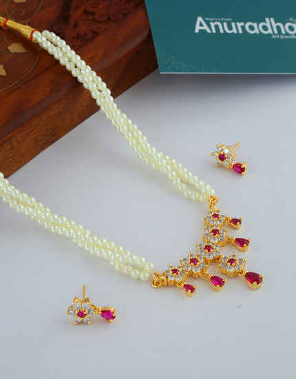 Fancy Pink Colour Gold Finish Floral Design Tikda Set Jewellery