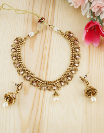 Adorable Gold Finish Traditional Necklace Studded With Stones Necklace For Girls