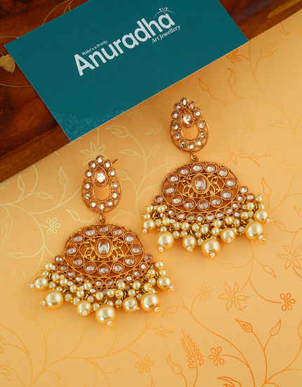 Gold Finish Traditional Earrings Styled With Moti Beads Earrings